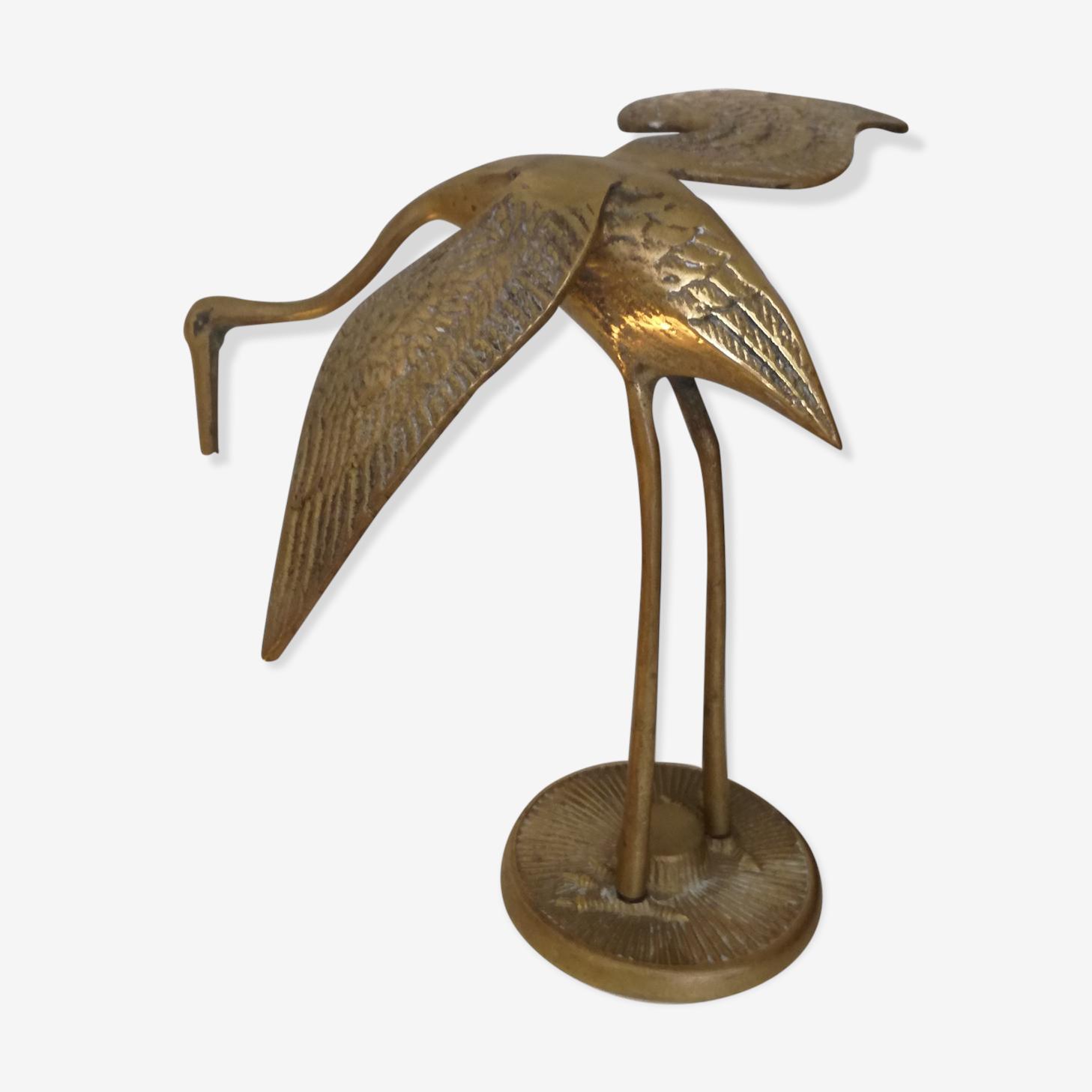 Heron vintage en laiton