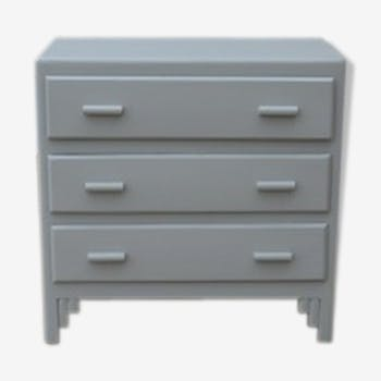 Old chest of drawers painted in light gray