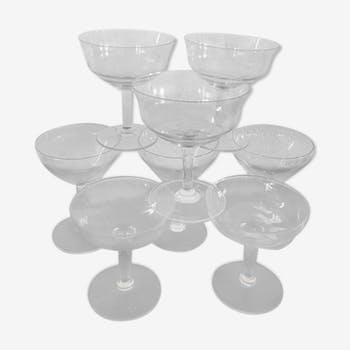 Eight old assorted champagne glasses