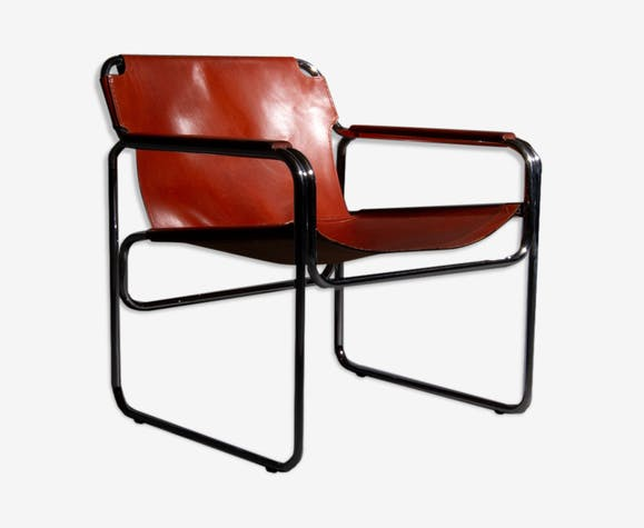 Tubular armchair with seating and armrests made of tan saddle leather