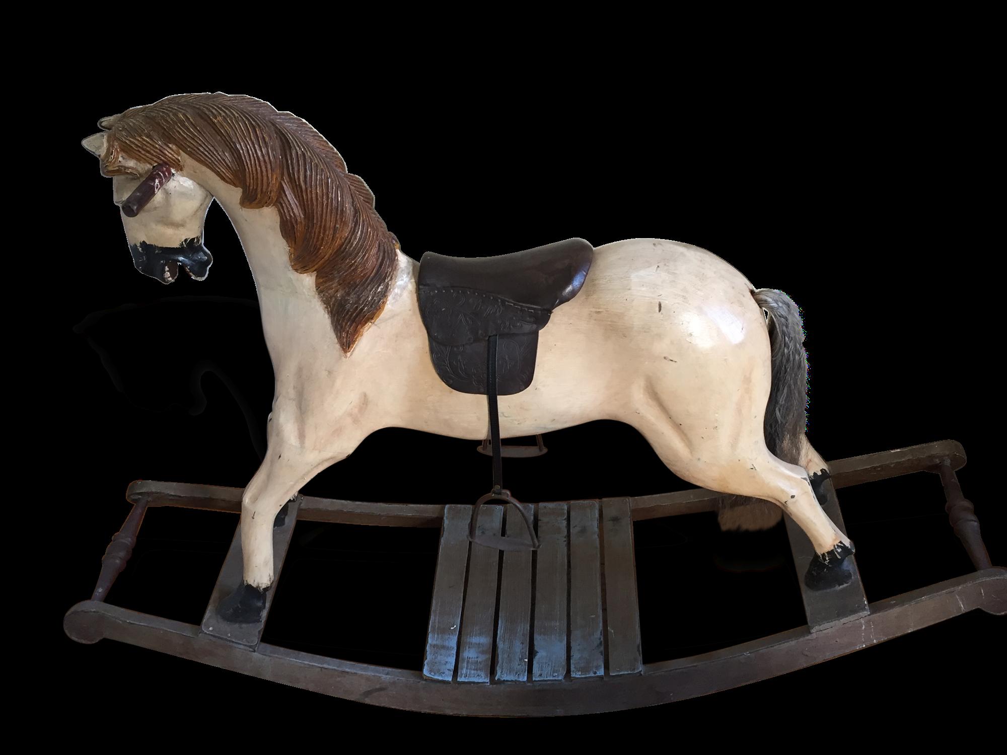 Ancien cheval à bascule en bois, cuir et
