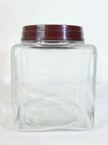 2 anciens bocaux epicerie en verre couvercle en bakelite