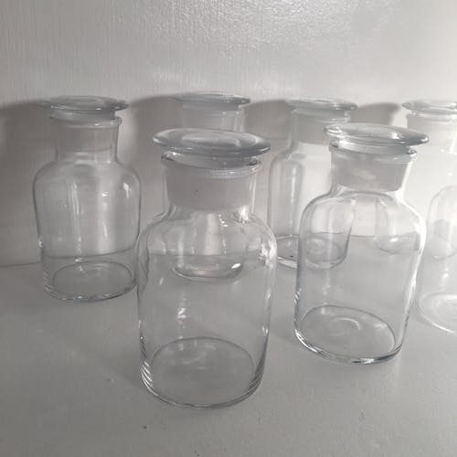 Transparent glass apothecary bottles