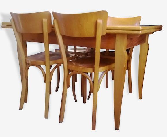 Table vintage Baumann et lot de quatre chaises