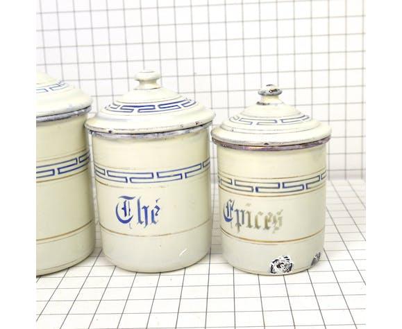 Cinq pots à épices en émail