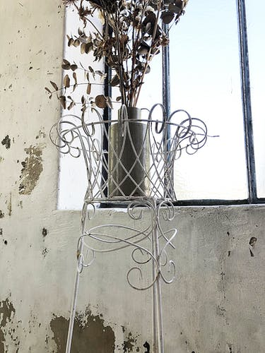 White metal plant holder