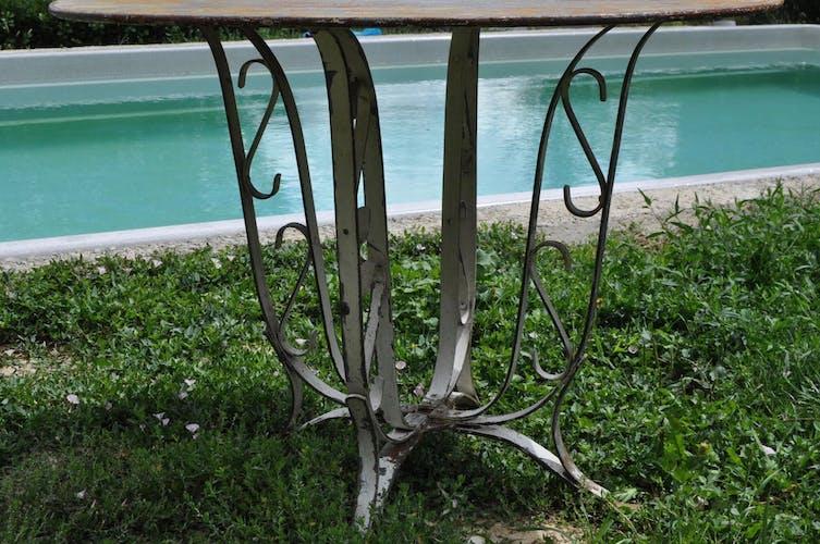 Sheet metal and iron garden table