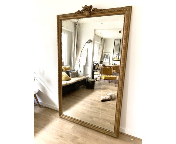 Golden mirror with old 19th pediment