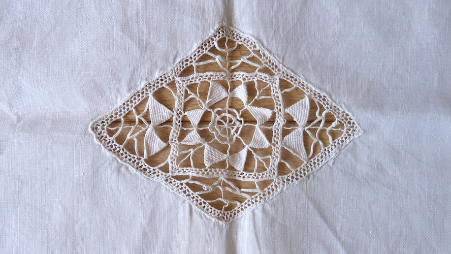 Old path or centerpiece in hand embroidered linen thread