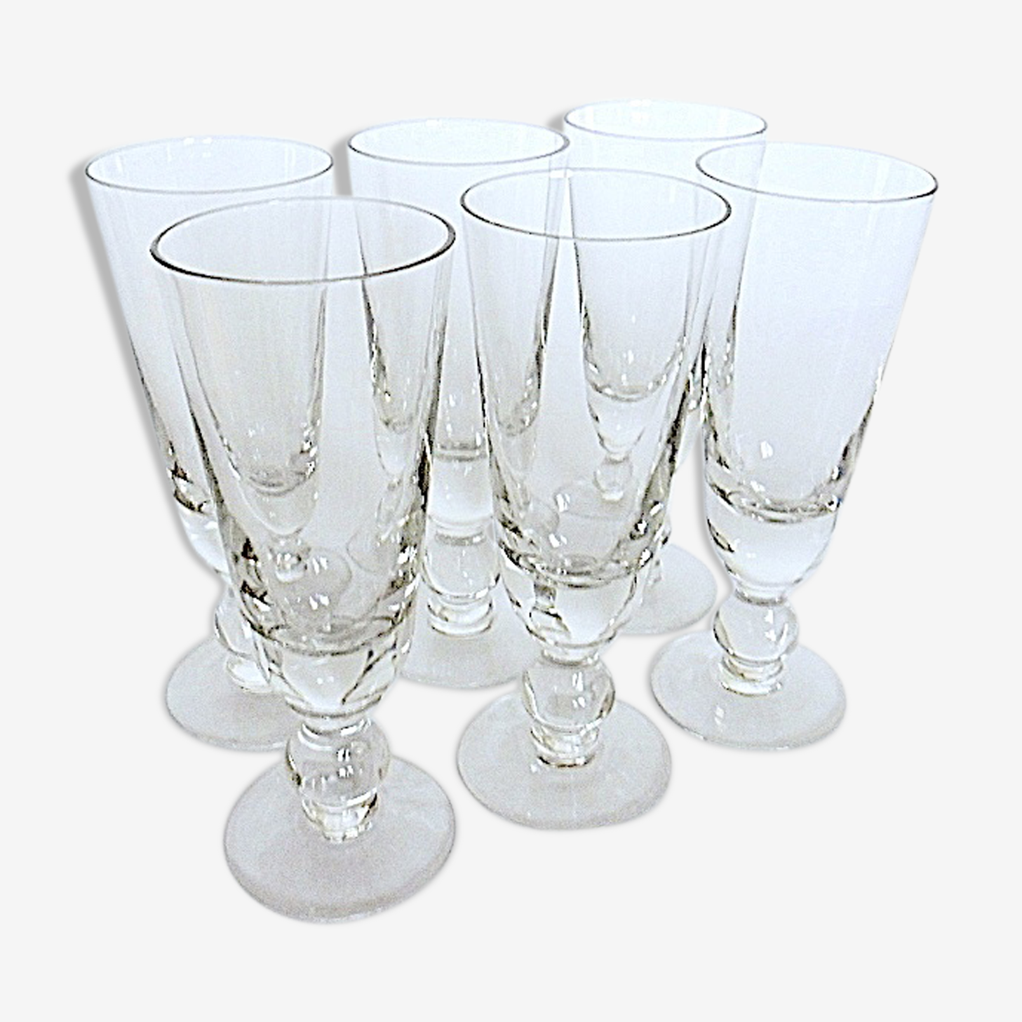 Suite of six former crystal champagne flutes