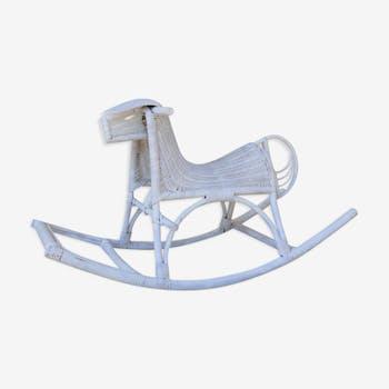White vintage rattan rocking horse