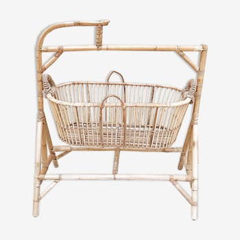 Rattan cradle with its support, mobile door