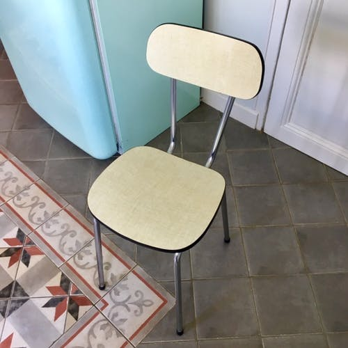 Lot of chairs in yellow formica
