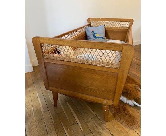Lit bébé en bois et osier