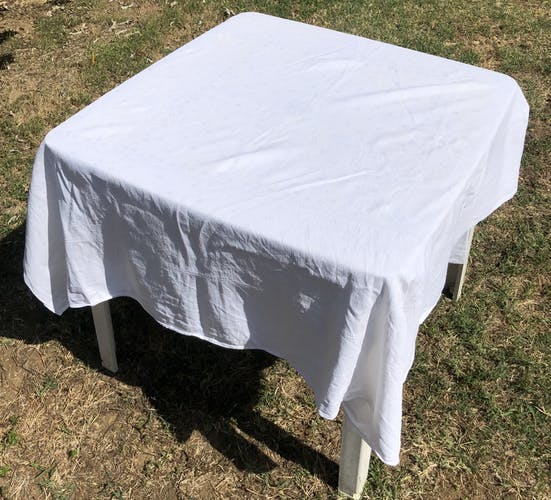 Old square table in damask cotton palm floral pattern