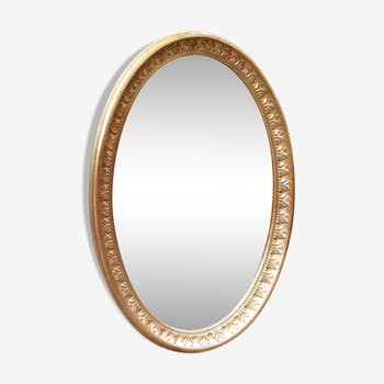 Golden carved wood oval mirror - 110x75cm