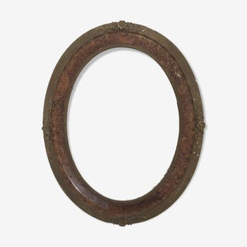 Oval frame in wood and gilded stucco