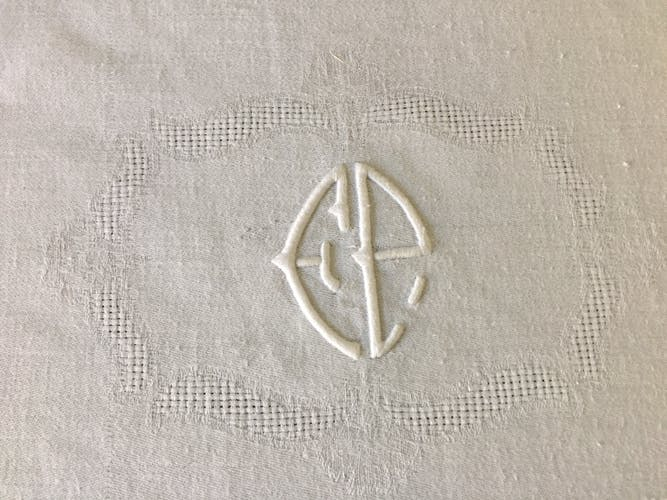 Damask tablecloth with central monogram