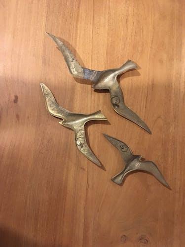 3 brass birds