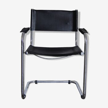 Vintage chrome and faux black leather armchair
