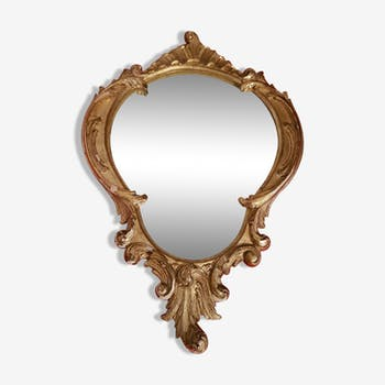 Miroir doré forme écusson 37 x 55 cm