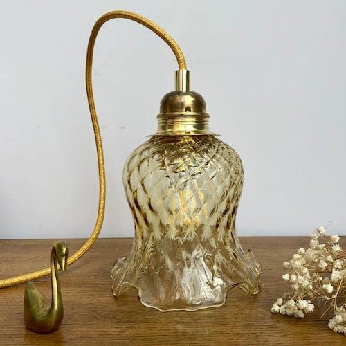 Baladeuse tulipe vintage en verre ambré