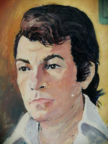 Portrait of a man signed and dated 1974