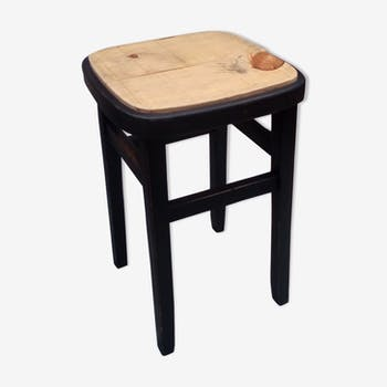 High wooden and patinated wood stool