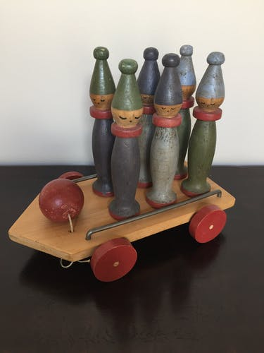 Jeu de quilles Moulin Roty sur chariot a roulettes