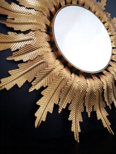 Miroir de soleil de la feuille d'or