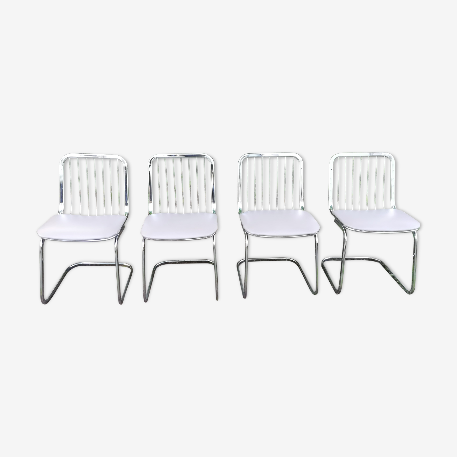 Set of 4 chromed and leatherette chairs