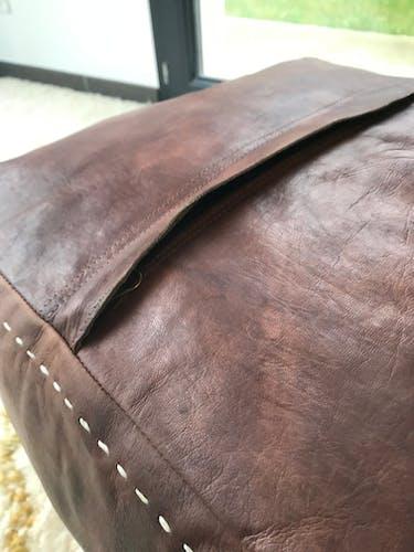 Pouf en cuir vintage