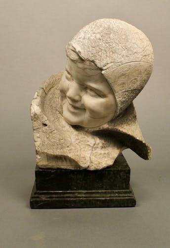 Tête d'enfant en pierre
