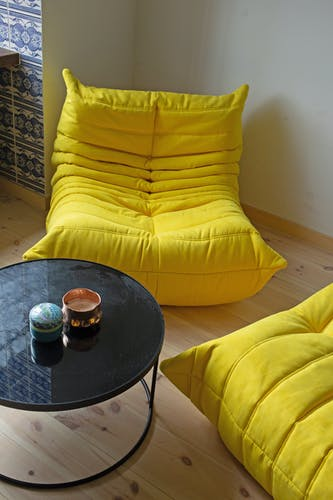 Armchair and pouf Togo in yellow fabric by Michel Ducaroy for Ligne Roset