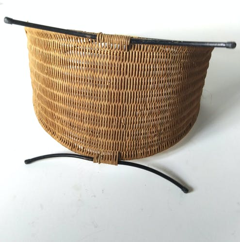 Rattan basket with logs