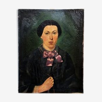 Painting portrait of woman with pink bow