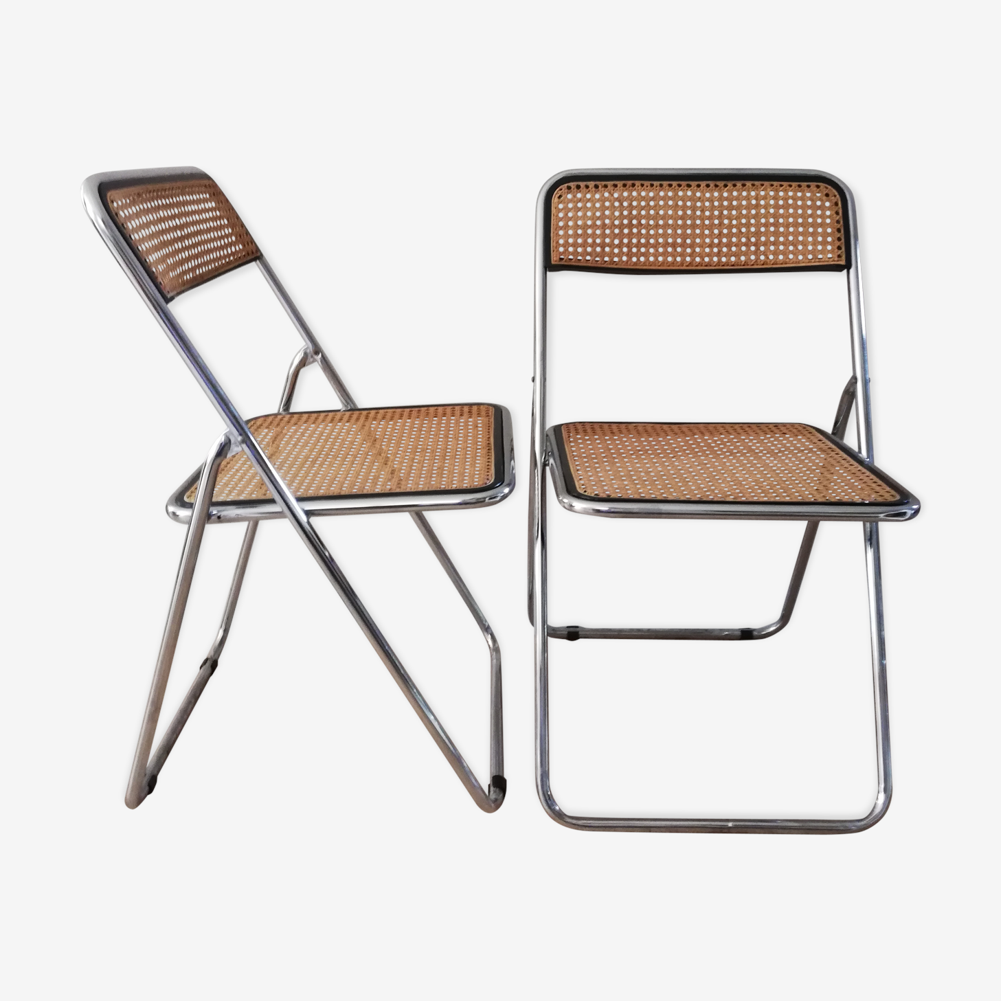 Pair of folding chairs in caning and chromed tube