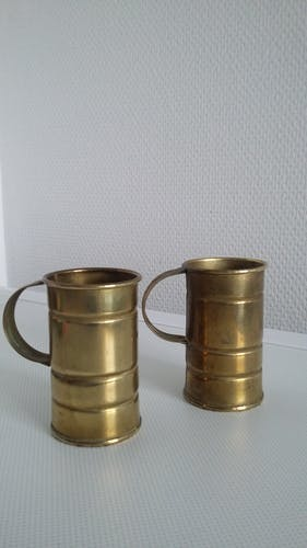 Pair of brass steins