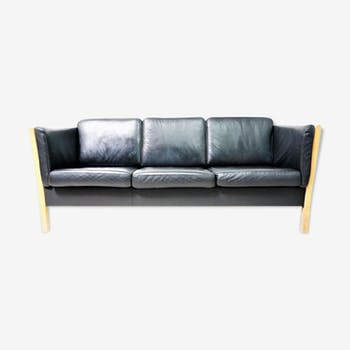 Scandinavian sofa in black leather and natural wood