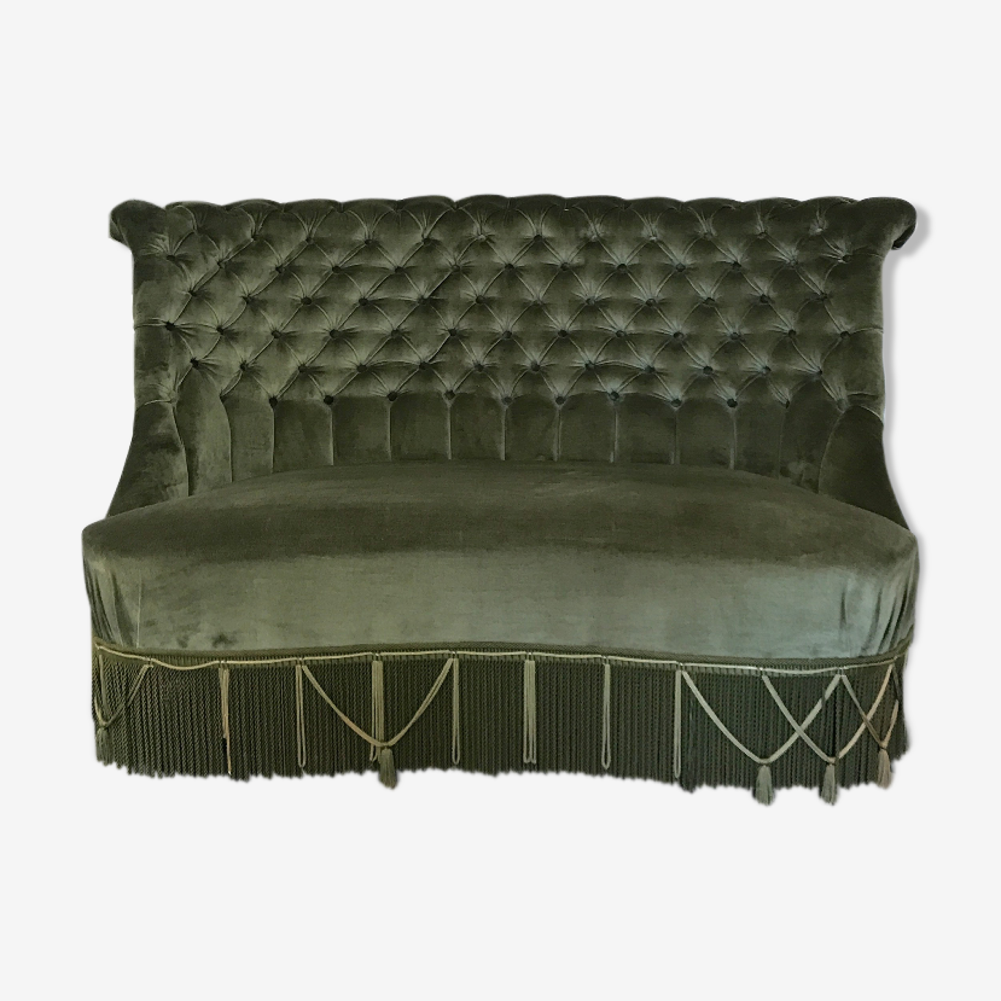 Toad in green velvet sofa