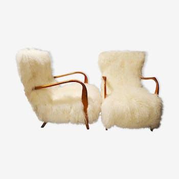 Paire de fauteuils en fourrure d'agneau