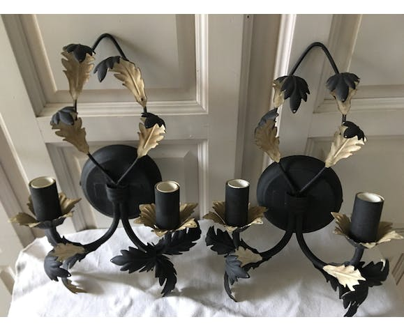 Pairs of black painted metal and golden beige