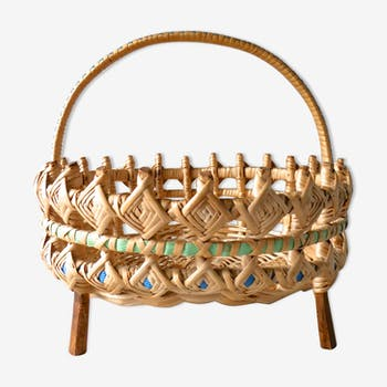In wood and woven rattan basket