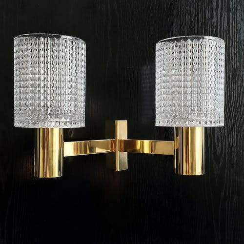 Wall lamp in solid brass and crystal by Carl Fagerlund 1960