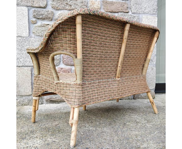 Vintage rattan and wicker sofa braided in color