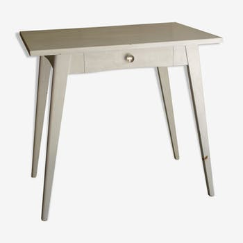 White compass feet table