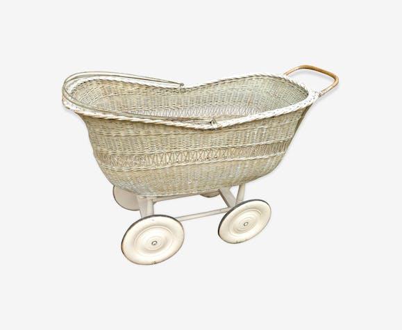 Vintage rattan cradle on wheels