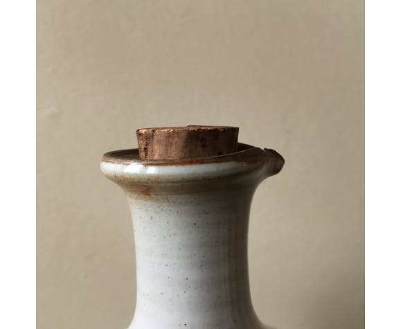Old stoneware pitcher with pouring spout and Cap