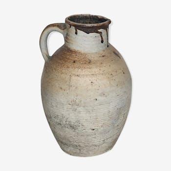 Ancient sandstone water jar, 1900