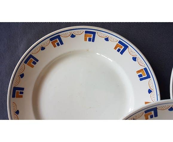 Suite de 4 assiettes en faïence de Lunéville